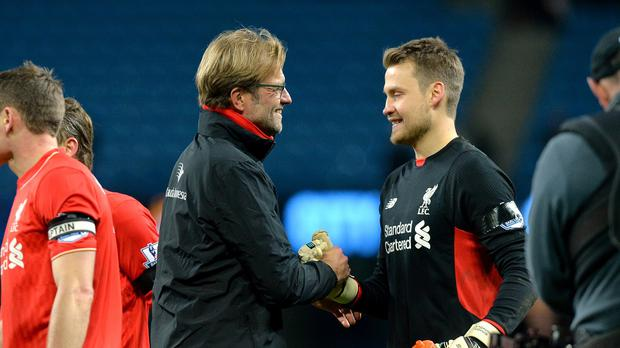 Jurgen Klopp wants Liverpool goalkeeper Simon Mignolet, right, to keep coming for crosses
