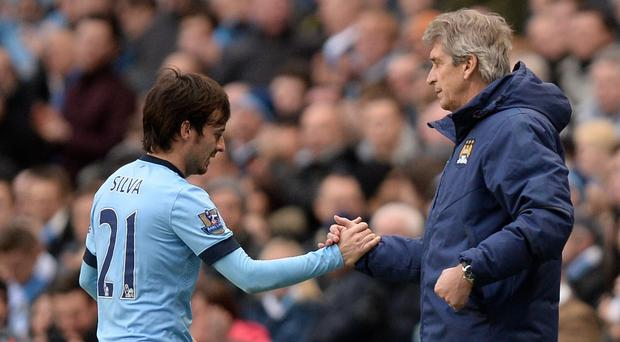 David Silva, pictured left, is fully behind Manchester City manager Manuel Pellegrini