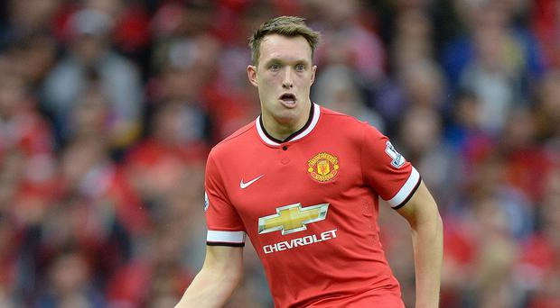 Manchester United's Phil Jones says the mood at the club is not as low as it was under David Moyes