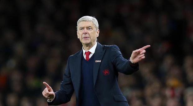 Arsene Wenger, pictured, will be without Alexis Sanchez until mid-January