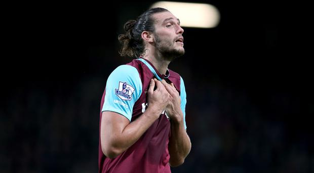 Andy Carroll has been told he has a future at West Ham