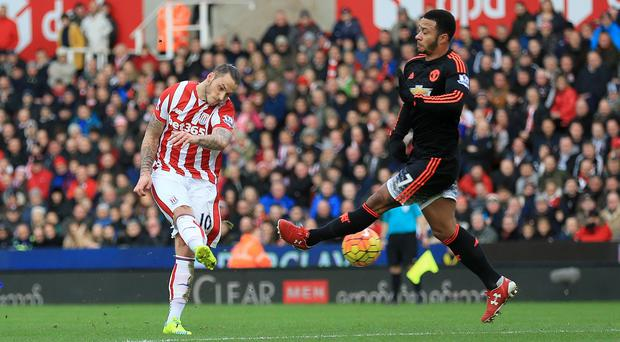 Marko Arnautovic, left, scores Stoke's second goal against Manchester United