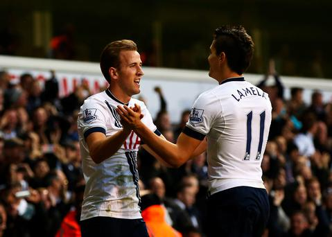 More than able: Tottenham hitman Harry Kane celebrates his brace in the win over Norwich on Boxing Day with Erik Lamela