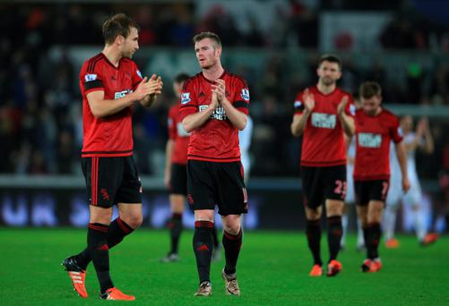 Dejected: West Brom's Northern Ireland international Chris Brunt looks downbeat after defeat at Swansea