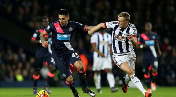 West Brom match winner Darren Fletcher battles with Newcastle's Aleksandar Mitrovic in Albion's 1-0 victory.