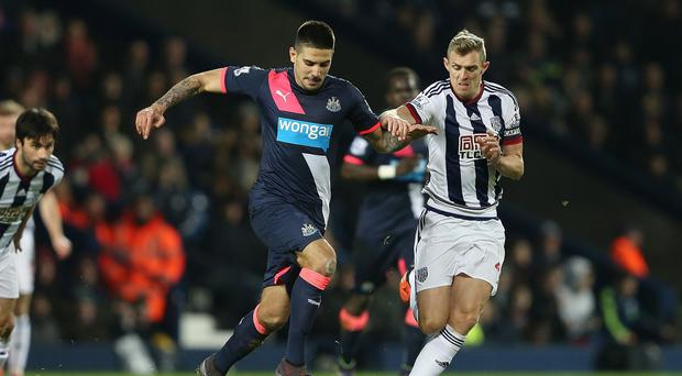 Newcastle's Aleksandar Mitrovic is challenged by West Brom match winner Darren Fletcher during the Baggies' 1-0 win.