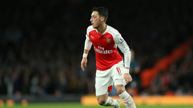 Arsenal's Mesut Ozil inspired a 2-0 win over Bournmouth