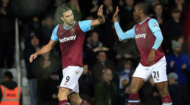 Andy Carroll, left, celebrates after heading West Ham's winner against Southampton