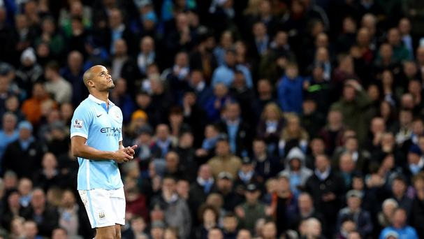 Manchester City's Vincent Kompany walks off injured during the Barclays Premier League match at the Etihad Stadium, Manchester.
