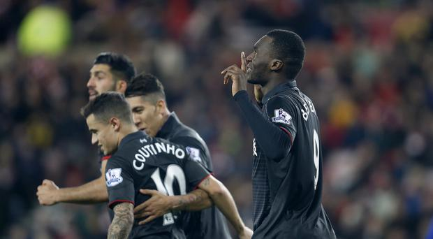 Liverpool boss Jurgen Klopp is confident there is more to come from striker Christian Benteke (right)