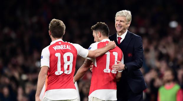 Arsenal manager Arsene Wenger (right) believes Mesut Ozil (centre) is developing into a leader in his squad