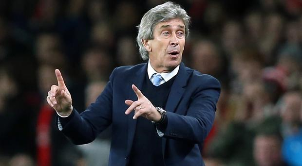 Happy: Manager Manuel Pellegrini is content with City's position in the league table at the halfway stage.