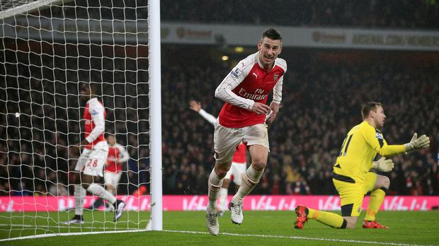 Laurent Koscielny, centre, wheels away in celebration after scoring Arsenal's winner