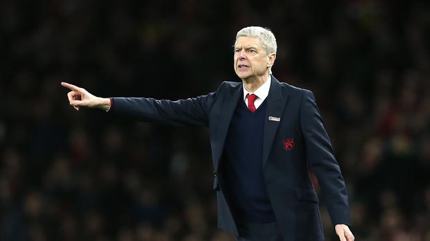 Arsene Wenger praised the mentality of his players after they moved clear at the top of the Barclays Premier League.