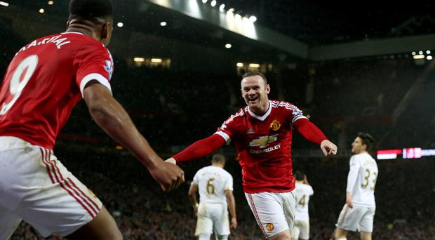 Wayne Rooney, right, celebrates his 238th goal for Manchester United