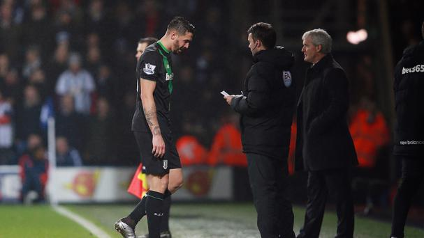 Geoff Cameron, left, walks after being sent off for Stoke