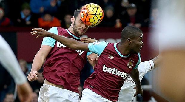 Andy Carroll, left, scored West Ham's second goal against Liverpool