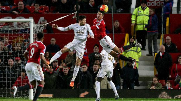 Chris Smalling wins a header in Manchester United's win over Swansea
