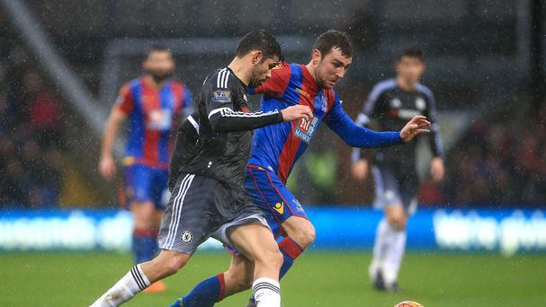 Crystal Palace midfielder James McArthur, right, holds off Diego Costa in the 3-0 defeat to Chelsea on Sunday
