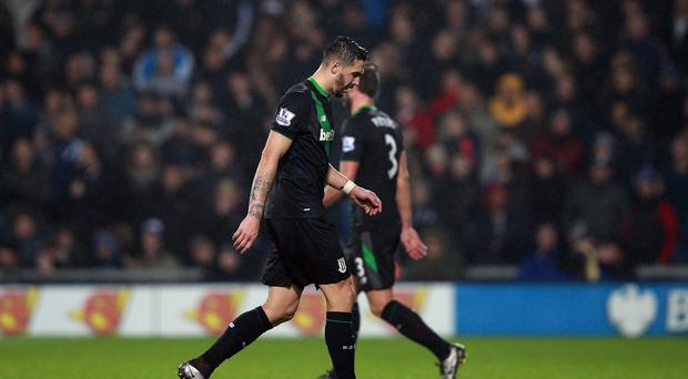 Geoff Cameron makes his way from the field of play after being sent off at West Brom