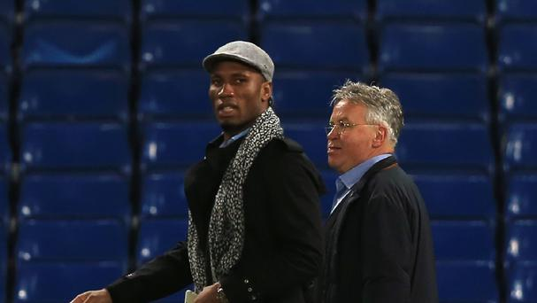 Didier Drogba (left) has again been linked with a return to Chelsea alongside interim manager Guus Hiddink (right)