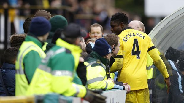 Aston Villa's Micah Richards (right) speaks to furious fans during their 1-1 FA Cup draw at Wycombe.