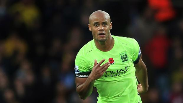 Manchester City's Vincent Kompany remains on the sidelines