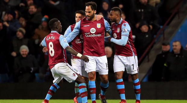 Joleon Lescott (centre) celebrates his winner for Aston Villa at home to Crystal Palace