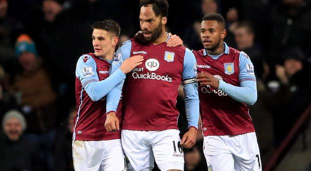 Joleon Lescott, centre, celebrates with Ashley Westwood, left, and Leandro Bacuna, right, after scoring in Aston Villa's 1-0 win over Crystal Palace.