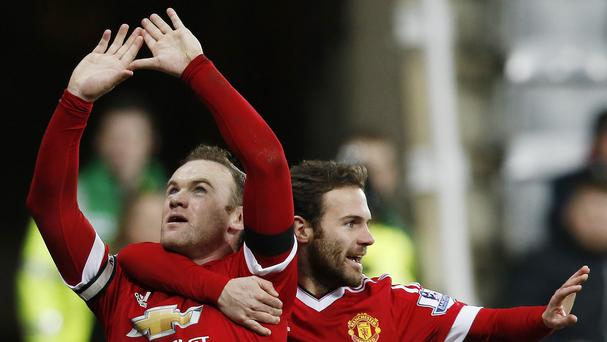 Wayne Rooney, left, scored twice but Manchester United were pegged back by Newcastle