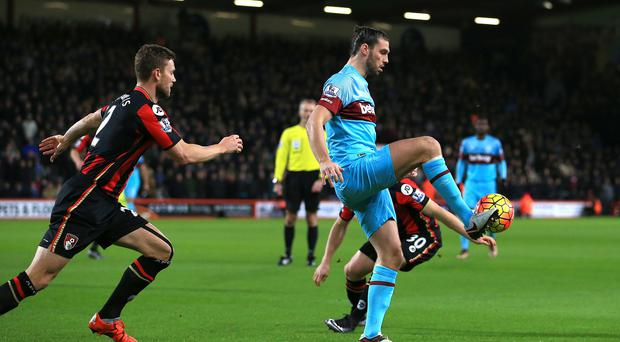 West Ham forward Andy Carroll (right) suffered another injury set-back during the match at Bournemouth