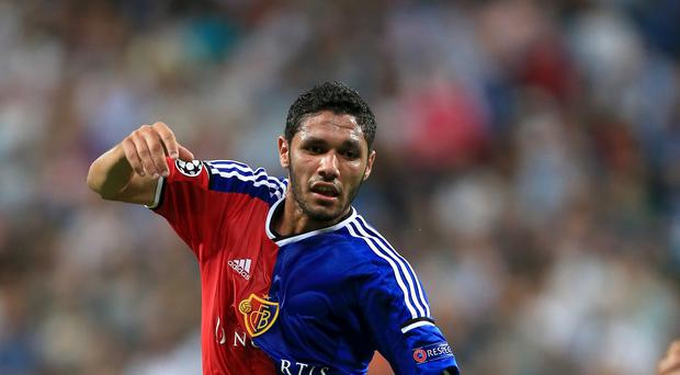 Arsenal manager Arsene Wenger is hoping to have Egypt midfielder Mohamed Elneny available for Sunday's trip to Stoke after he received the necessary paperwork.
