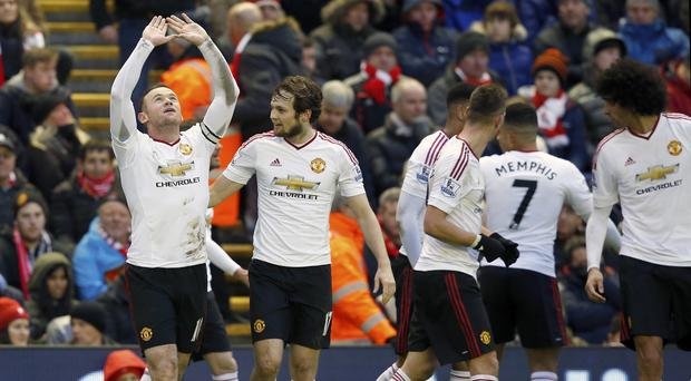 Wayne Rooney (left) celebrates his goal against Liverpool