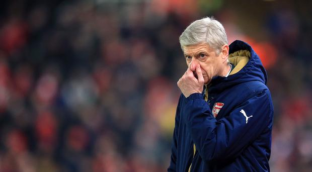 Arsene Wenger's Arsenal went back to the top of the table on Sunday