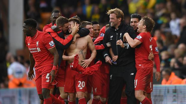 Liverpool manager Jurgen Klopp lost his glasses when getting involved in the celebrations