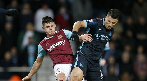 Sergio Aguero, right, scored twice to rescue a point for Manchester City at West Ham