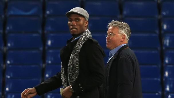 Didier Drogba, left, will not be linking up with Guus Hiddink, right, at Chelsea