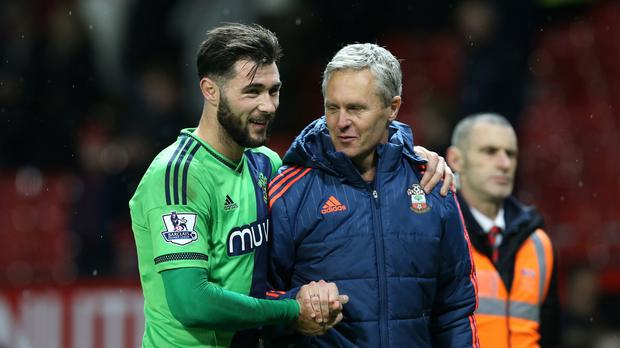 Charlie Austin, pictured left, celebrates with coach Jan Kluitenberg after scoring Southampton's winner at Old Trafford