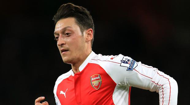 Arsenal's Mesut Ozil is the subject of a buy-back agreement with former club Real Madrid, leaked documents show