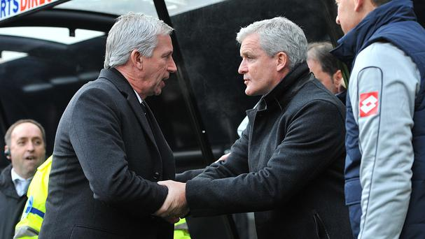 Alan Pardew, left, has respect for the job done by Mark Hughes, right, at Stoke