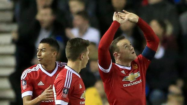 Wayne Rooney [right] celebrates his goal at Derby on Friday as he closes in on Sir Bobby Charlton's record