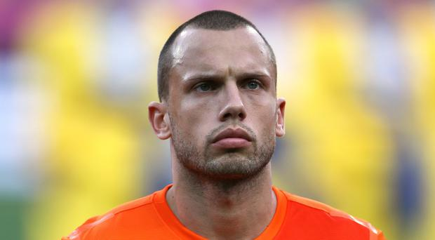 John Heitinga won 87 caps for Holland