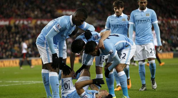 Sergio Aguero, bottom, was on target for Manchester City