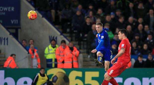 Jamie Vardy (left) scores a brilliant opener in Leicester's 2-0 win over Liverpool.