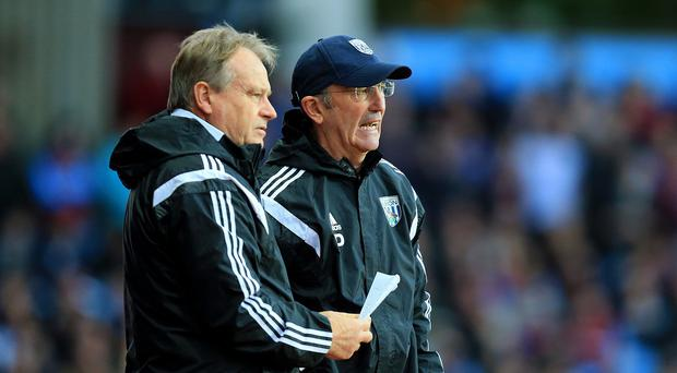 West Brom assistant manager Dave Kemp, left, does not agree with the Hawthorns boo boys