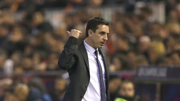 Arsene Wenger has backed Valencia manager Gary Neville (pictured) to turn things around at the Mestalla.