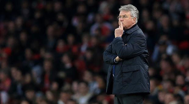 Guus Hiddink believes there is still a lot at stake when Chelsea host Manchester United on Sunday