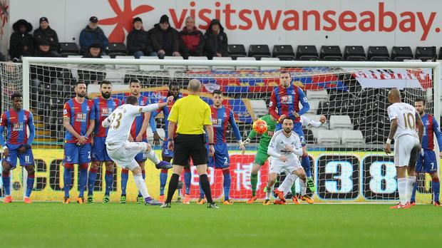 Gylfi Sigurdsson fires Swansea ahead from a free-kick