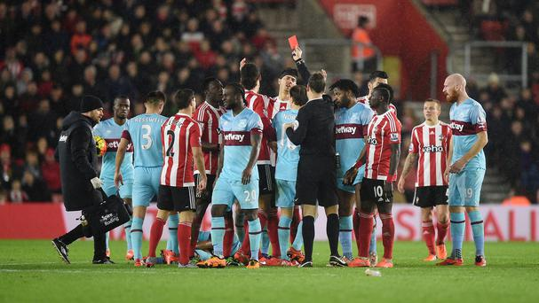 Victor Wanyama, fifth left, was shown his third red card of the season by referee Mark Clattenburg