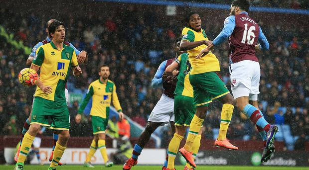 Joleon Lescott heads in Aston Villa's opener in their 2-0 Barclays Premier League win over Norwich